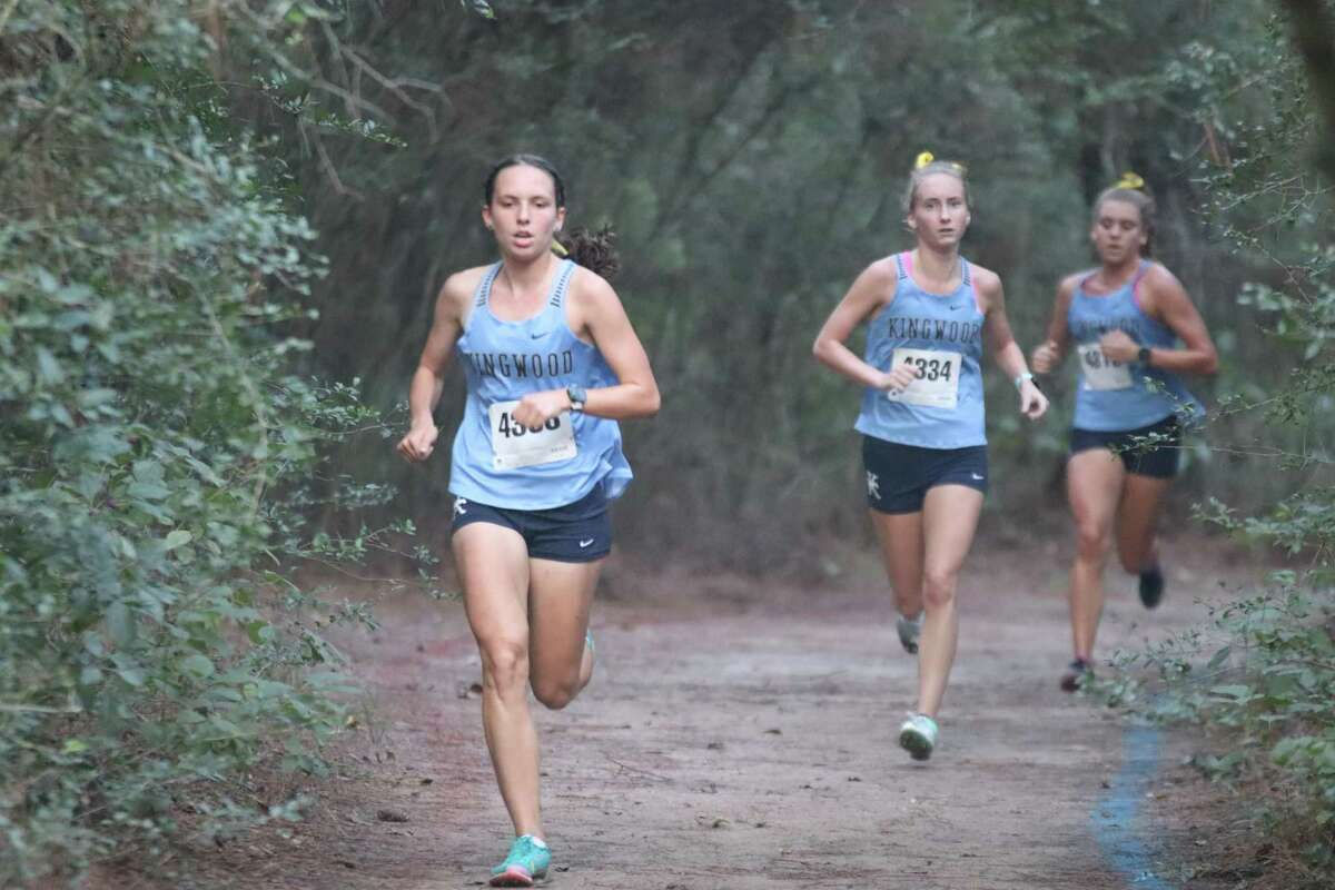 Kingwood's Ana Small (first), Lauren Johansson (second), and Carly Ahrens (third) running the course at the Andy Wells Invitational at Atascocita High School.