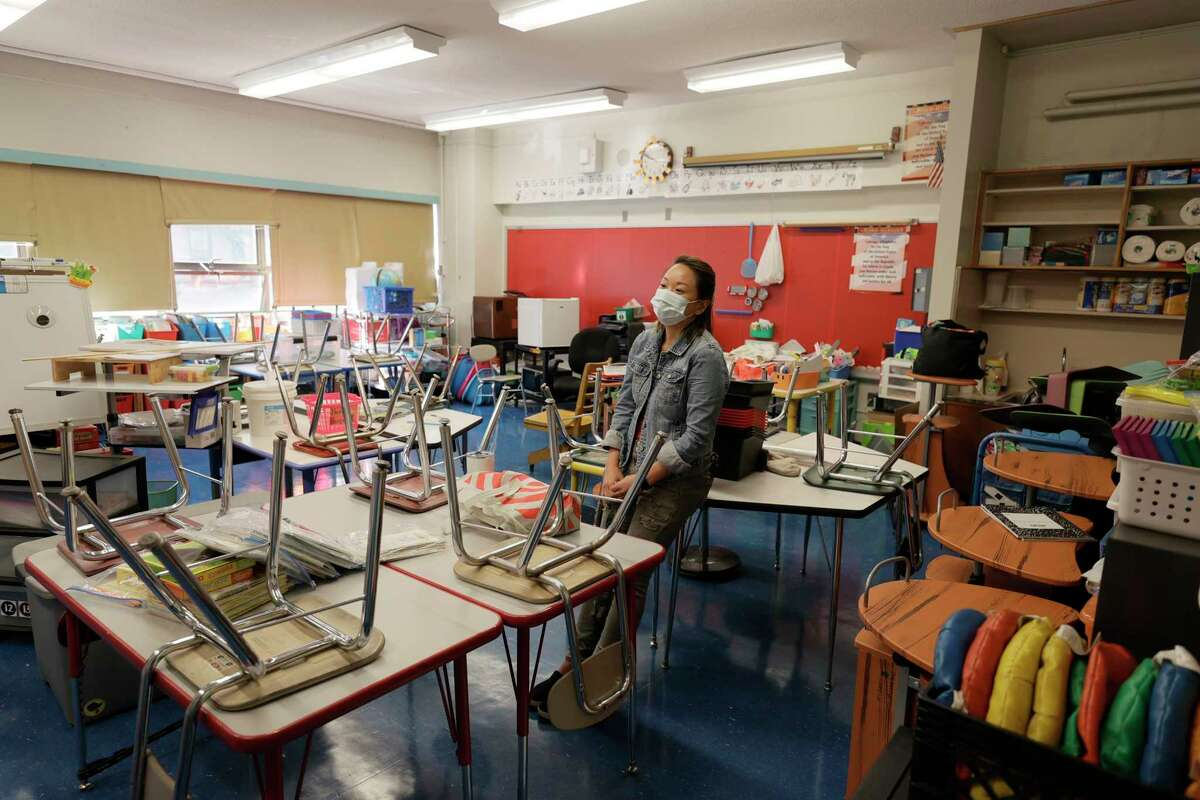 Laura Lai, a teacher at Yung Wing School P.S. 124, surveys her classroom in preparation for the coming start of school on September 2, 2021 in New York City. (Michael Loccisano/Getty Images/TNS)