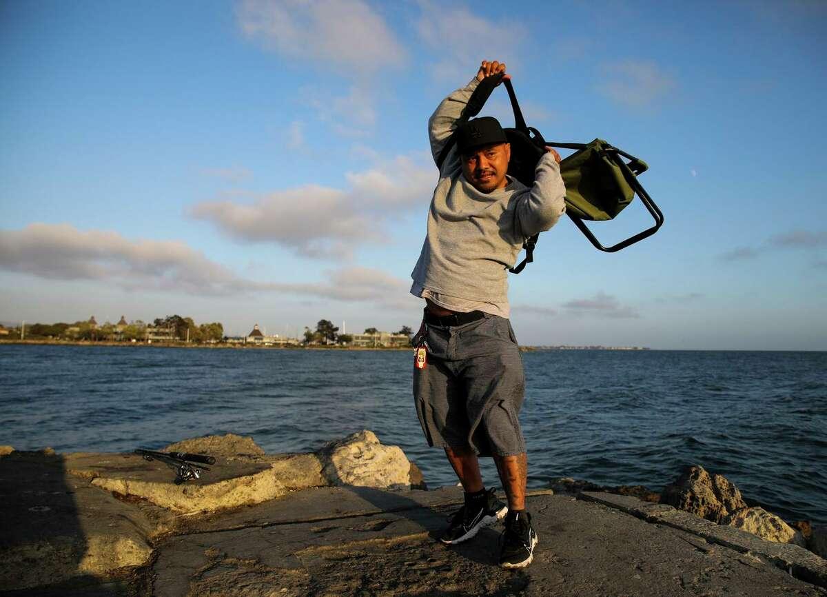 Chanthon Bun gathers his belongings after fishing in Alameda.
