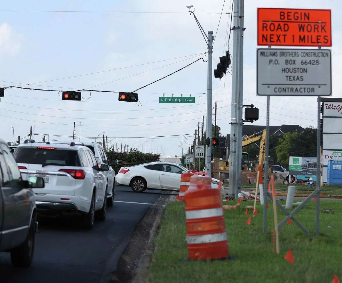 Traffic moves toward the intersection of FM 1960 and North Eldridge Parkway on Sept. 21, 2021, in Houston, one of several areas where crews are making road repairs. The project, along with dozens of others, was delayed this year, leading to an abundance of late projects piling up for transportation planners.
