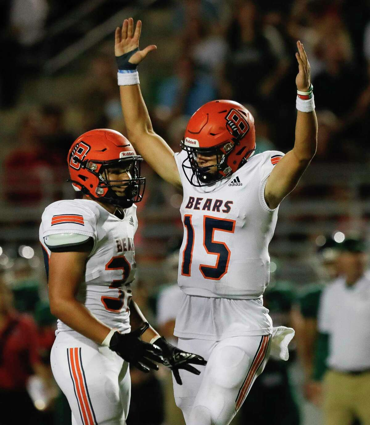 Bridgeland quarterback Conner Weigman (15) reacts after throwing a 12-yard touchdown to wide receiver Andrew Maleski during the third quarter of a non-district high school football game at Woodforest Bank Stadium, Friday, Sept. 10, 2021, in Shenandoah.
