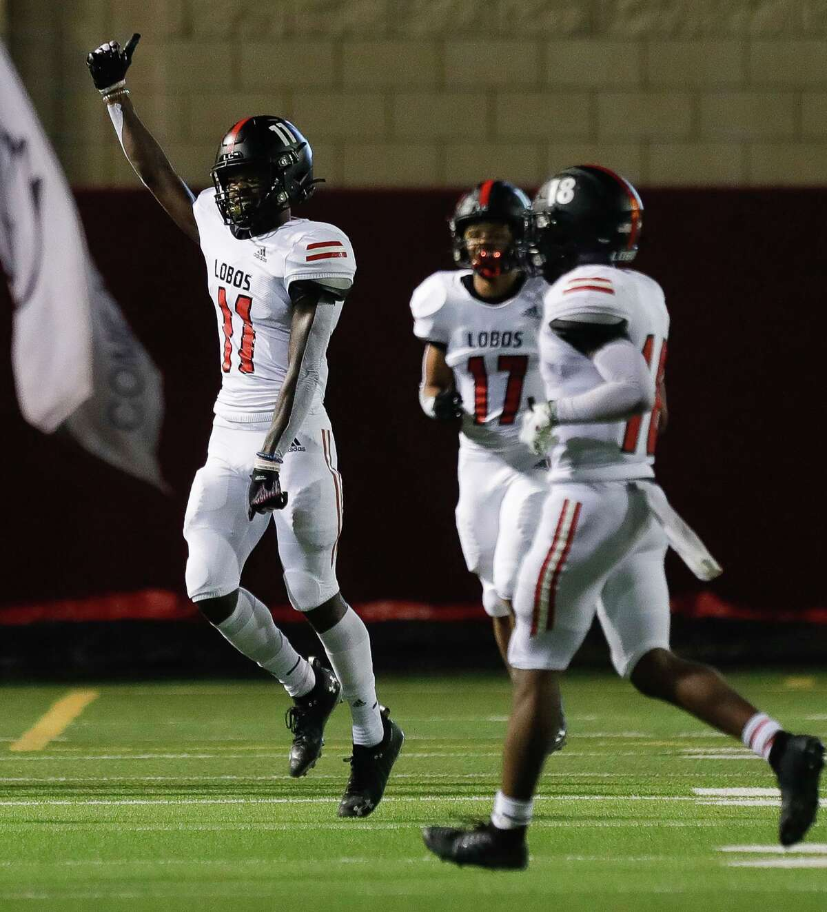 Langham Creek wide receiver Jaquaize Pettaway (11) reacts after scoring a 74-yard touchdown during the second quarter of a non-district high school football game at Woodforest Bank Stadium, Thursday, Aug. 26, 2021, in Shenandoah.