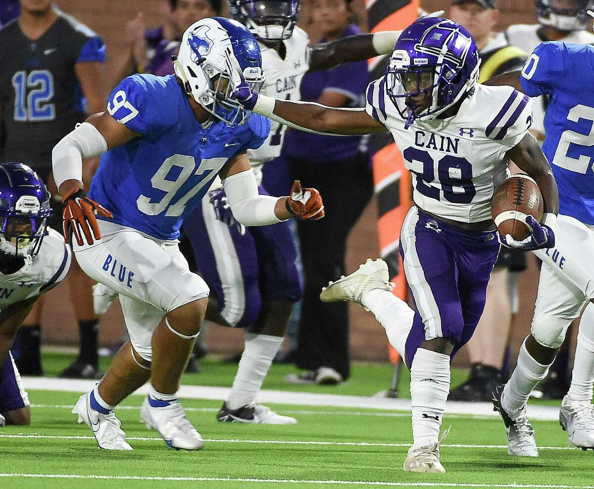 Klein Cain running back Drew Stokes (28) fends off Katy Taylor defensive back Ron Young III during the first half of a high school football game, Friday, Sept. 17, 2021, in Katy.