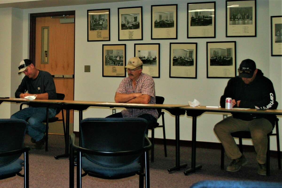 Jake Walston, street supervisor for Big Rapids (far left), Larry Burke with DTE Energy (center) and Cody Wyman, Big Rapids engineer technician participate in the preconstruction meeting for the Hemlock Park utility project last week. (Pioneer photo/Cathie Crew)