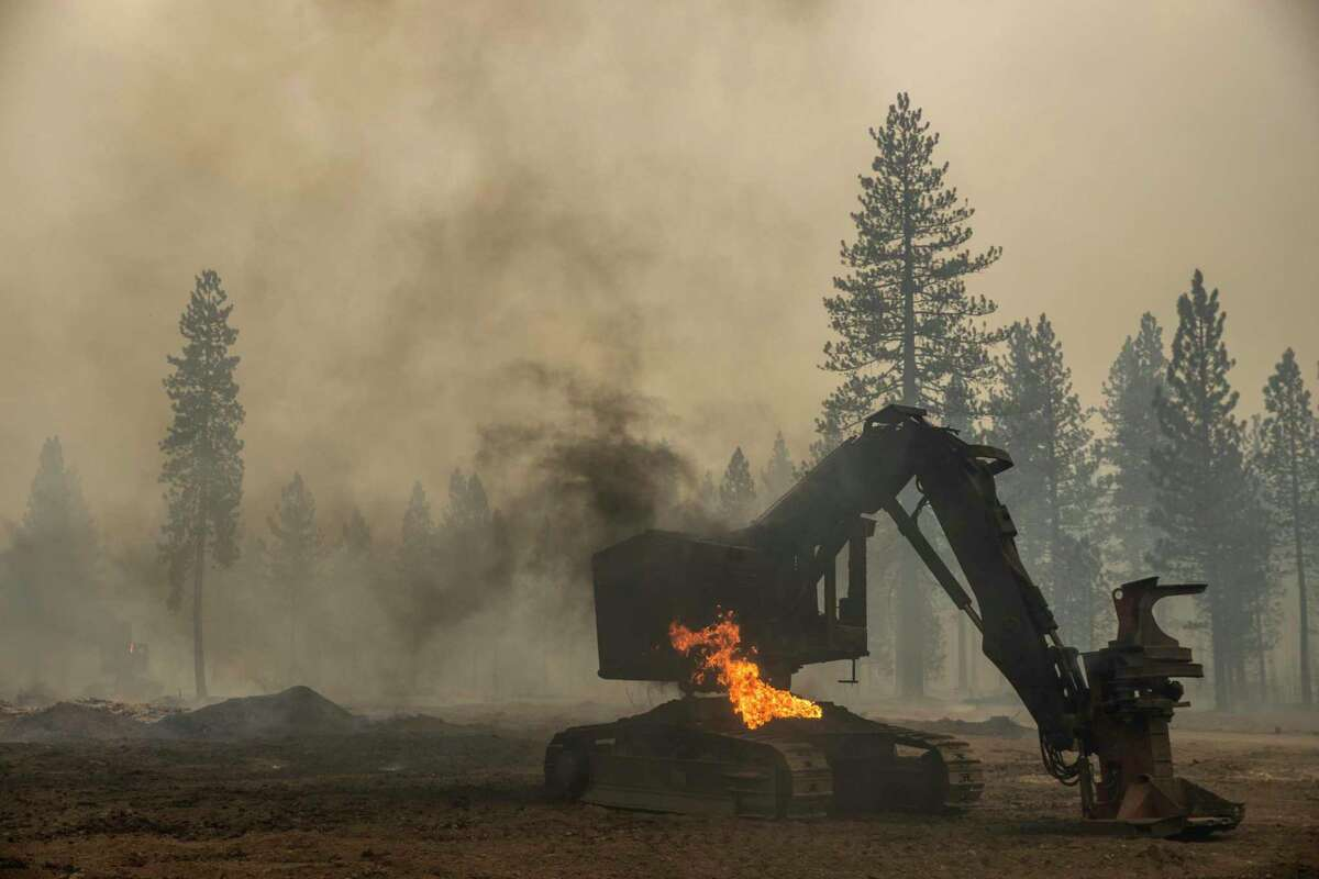 Burned-out heavy equipment along County Road 324 during the Dixie Fire in Chester (Plumas County) on Aug. 4.