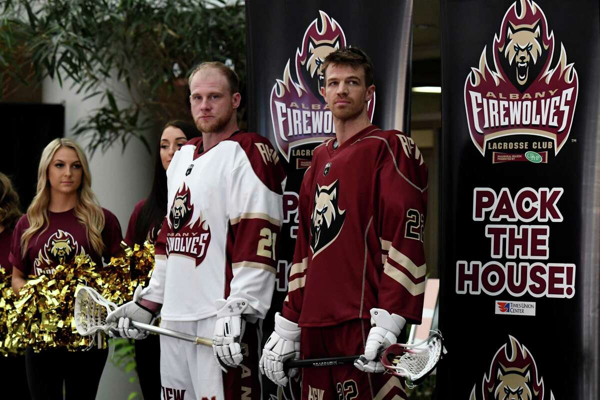Albany FireWolves National Lacrosse League players, Joe Resetarit, left, and Greg Downing, right, model the new away and home uniforms on Tuesday, Sept. 21, 2021, during a press conference at the Times union Center in Albany, N.Y.