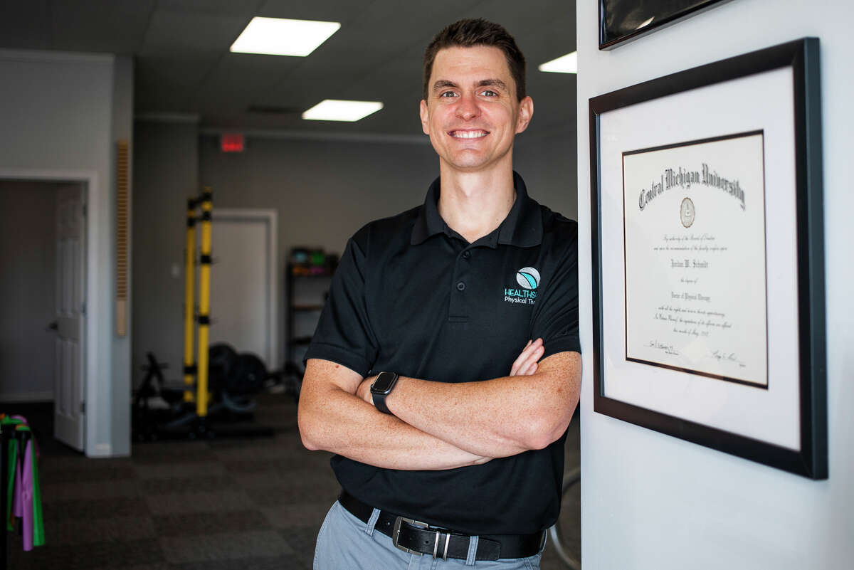Dr. Jordan Schmidt poses for a portrait Thursday, Sept. 9, 2021 inside his newly opened clinic, HealthSpan Physical Therapy, located at 4424 N. Saginaw Road in Midland. (Katy Kildee/kkildee@mdn.net)