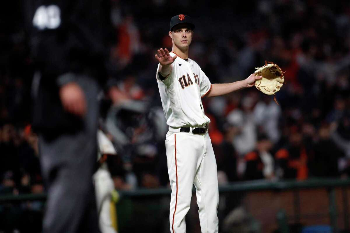 San Francisco Giants' Tyler Rogers looks for an umpire to check his equipment in 8th inning against St. Louis Cardinals during MLB game at Oracle Park in San Francisco, Calif., on Wednesday, July 7, 2021.