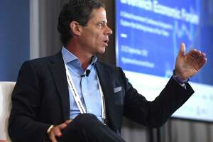iCapital Network CEO and Chairman Lawrence Calcano speaks during a panel discussion on the first day of the 2021 Greenwich Economic Forum on Tuesday, Sept. 21, 2021, at the Delamar hotel at 500 Steamboat Road in Greenwich, Conn.