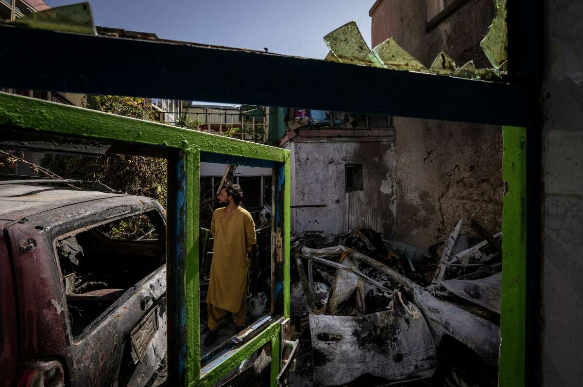 A man inspects the remains of Zemerai Ahmadi's house in Kabul on Sept. 13. The home was destroyed in a U.S. drone strike in August that killed 10 family members.