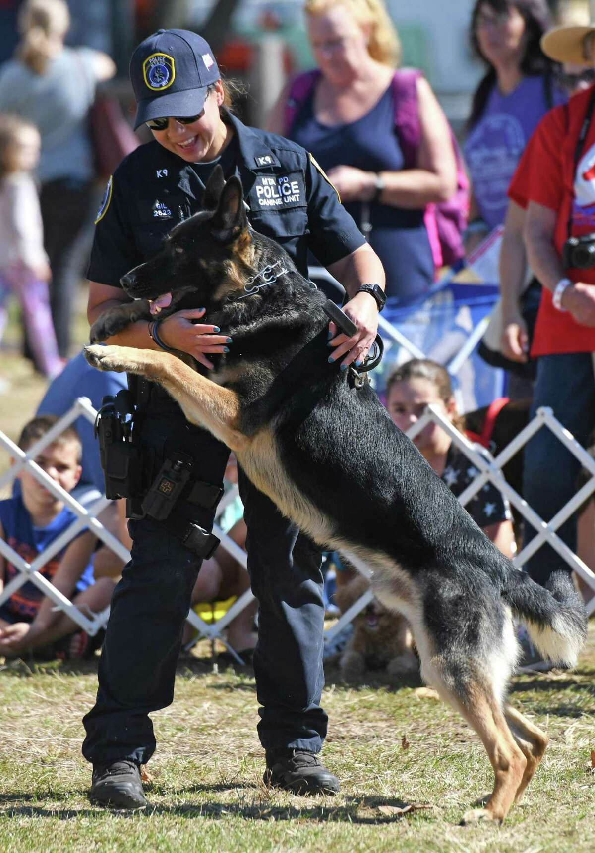 New York State Police Officer Gil puts on a demonstration with her K-9 Willy at Adopt-A-Dog's annual Puttin' on the Dog fundraising event at Roger Sherman Baldwin Park in Greenwich, Conn. Sunday, Sept. 29, 2019. Hundreds of humans and their canine companions enjoyed dog demonstrations and competitions, pet vendors on display, children's activities, food trucks and more.