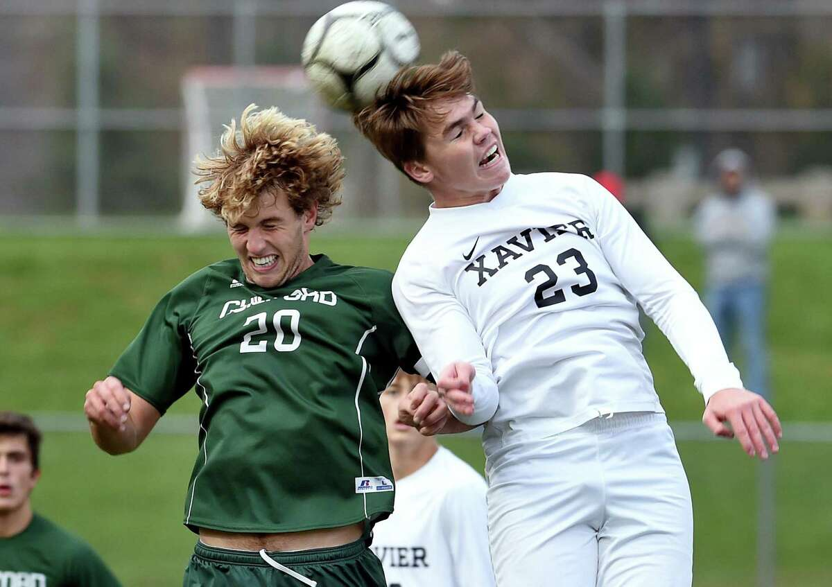 Guilford's Aidan Buchanan, left, and Brady Stevenson of Xavier fight to head the ball in the second half in 2020.