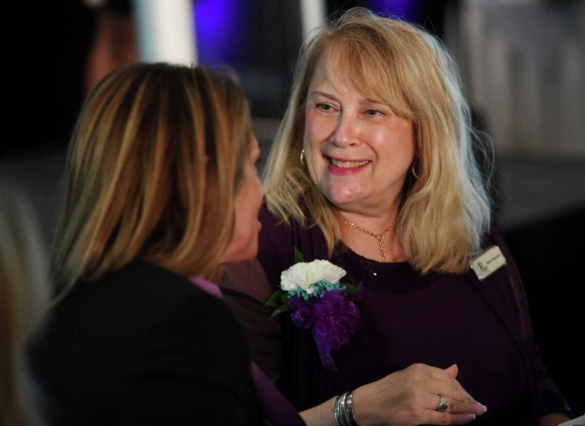 Center for Family Justice President and CEO Debra Greenwood, right, at the annual Speaking of Women fund raising luncheon at The Waterview in Monroe, Conn. on Tuesday, September 20, 2021.