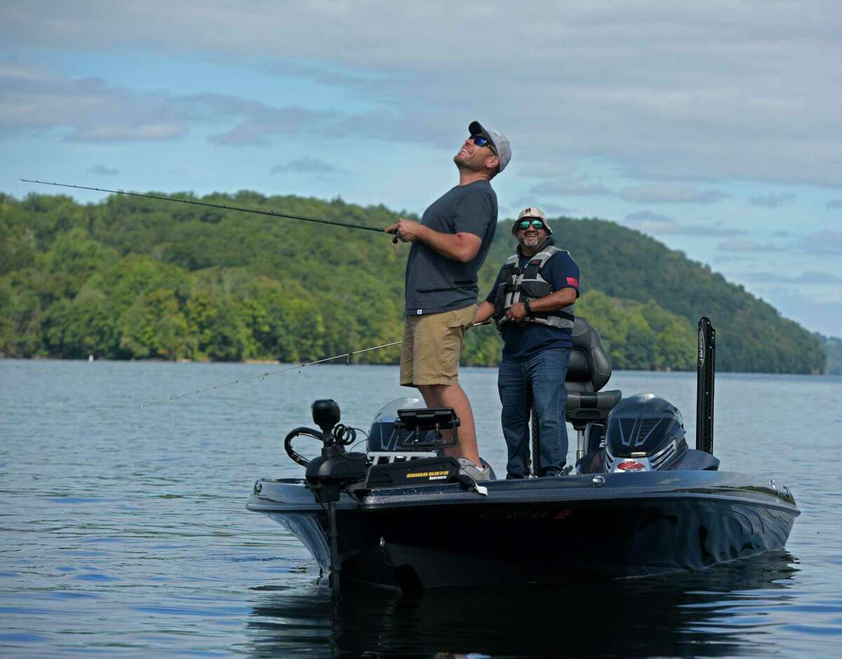 Boat captain Ed Grobali, left, and veteran Roberto Santos enjoy a moment on the water. Santos was one of the 24 veterans who participated in the Candlewood Lake Veteran's Fishing Tournament, organized in partnership with Connecticut BASS Nation and the Major Steven Roy Andrews Fishing Outreach Program on Tuesday, September 21, 2021, in Danbury, Conn. Each veteran was paired with an experienced boat captain from CT Bass Nation for the day on Candlewood Lake.
