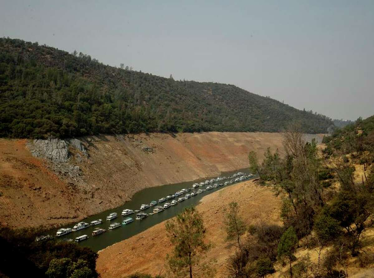 Houseboats rest in a channel at Lake Oroville State Recreation Area last month. The lake is at only 22% of capacity.