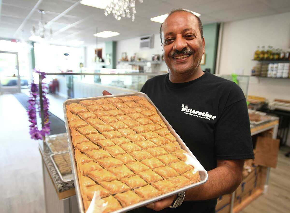 Owner Khaled H. Khaled holds one of his specialty baklavas at Nutcracker, his new family business at 1555 Black Rock Turnpike in Fairfield, Conn. on Tuesday, September 21, 2021.