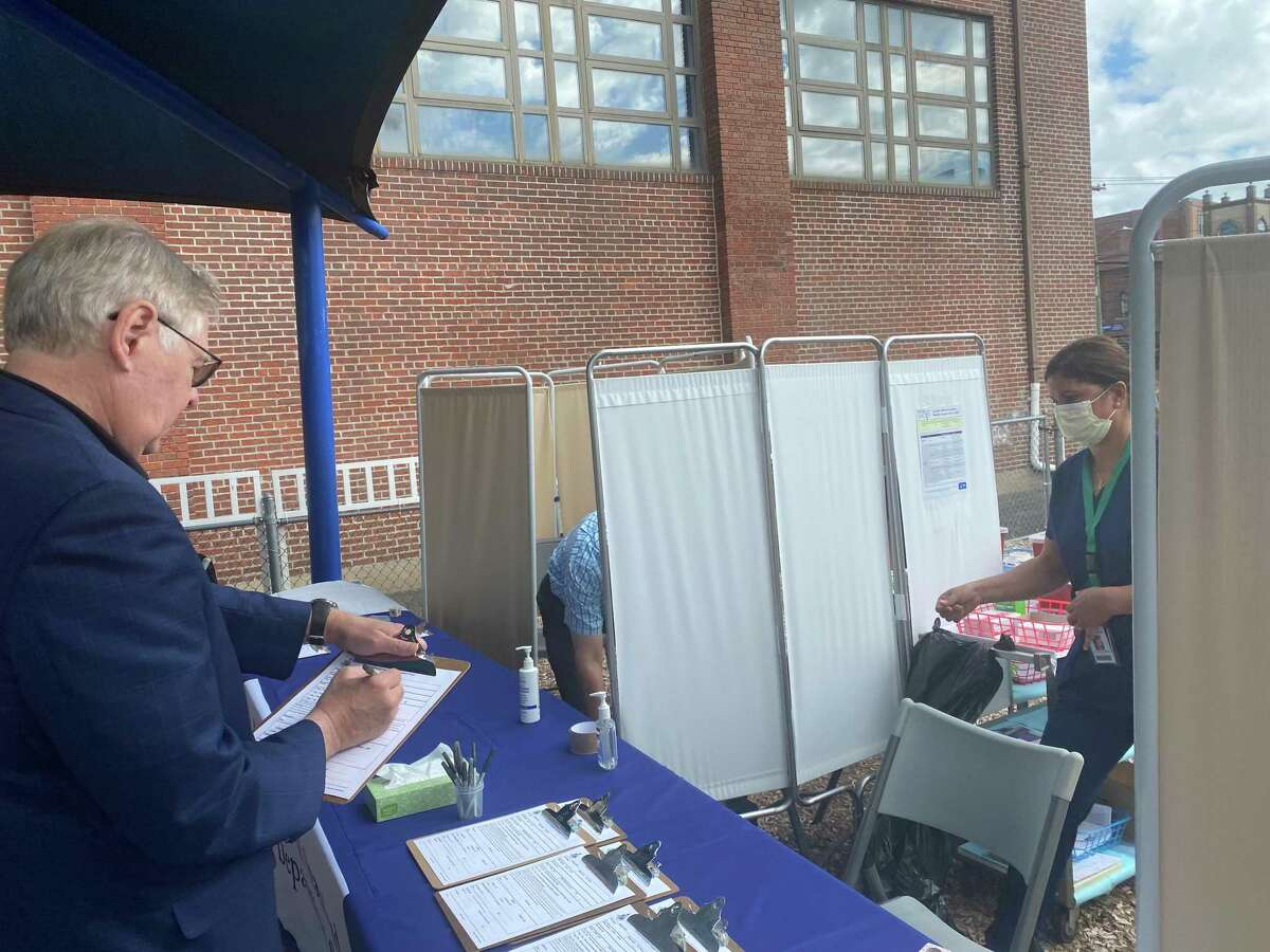 Mayor David Martin registers for his annual flu vaccine at Stamford's flu season kickoff event at the Lathon Wilder Community Center on Tues. Sept. 21, 2021.