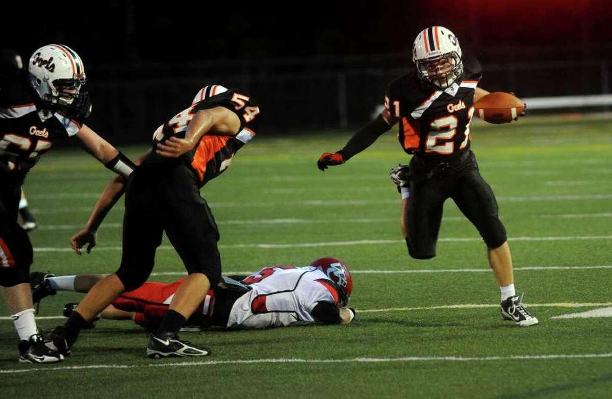 Shelton High School's Ryan Brighindi runs the ball during Friday's game against Wilbur Cross High School on September 17, 2010.