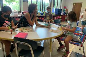 Students at Frisbie Elementary School in Wolcott, Conn., gather for small group instruction.