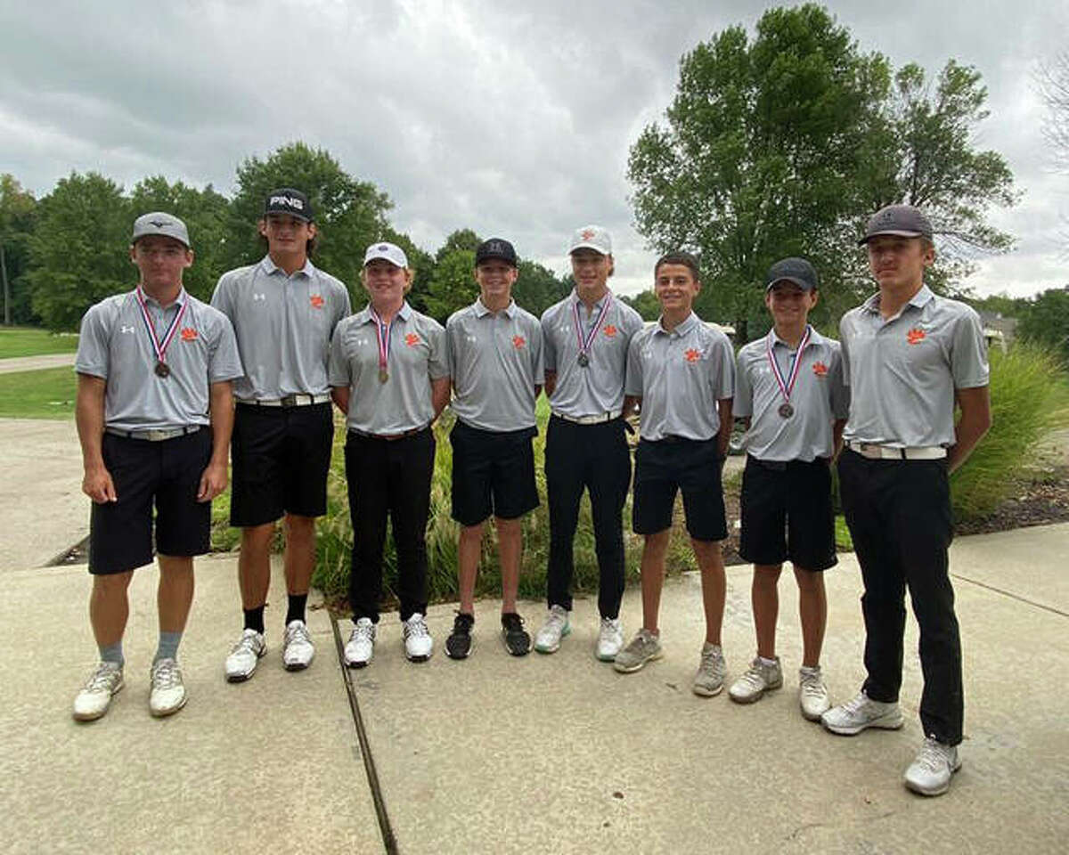 Members of the Edwardsville boys golf team pose together after winning the Southwestern Conference championship on Tuesday at Stonewolf Golf Club in Fairview Heights.