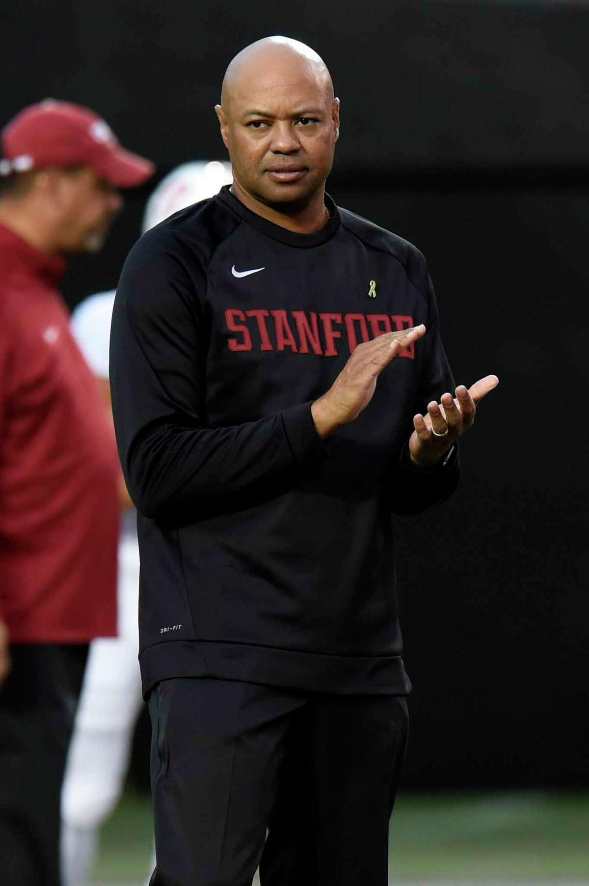 Stanford head coach David Shaw watches players warm up before an NCAA college football game against Vanderbilt Saturday, Sept. 18, 2021, in Nashville, Tenn. (AP Photo/Mark Zaleski)