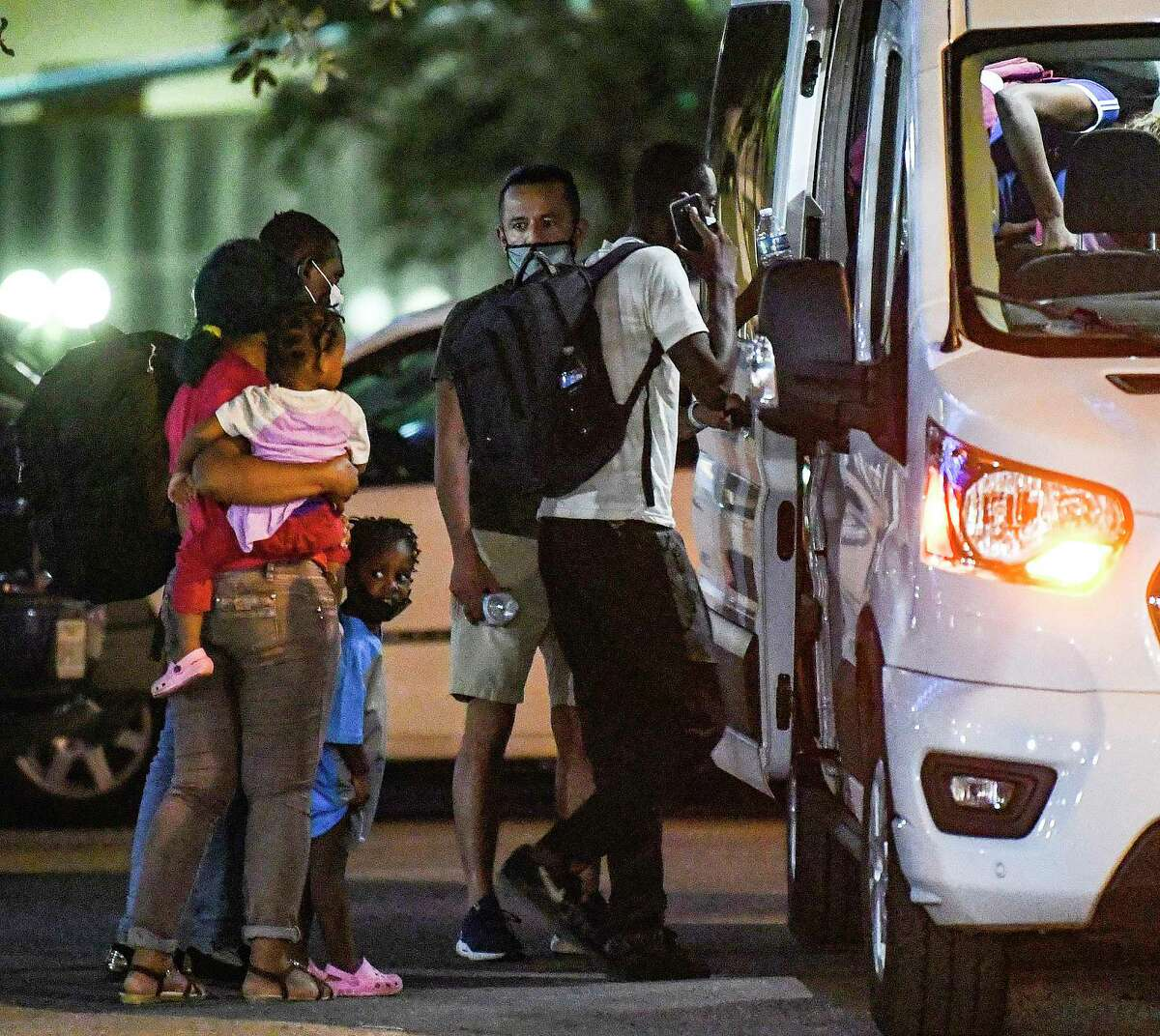 Migrants arrive at the downtown San Antonio bus station on Monday evening, Sept. 20, 2021. Some said that they were from Haiti and did not know where they were going.