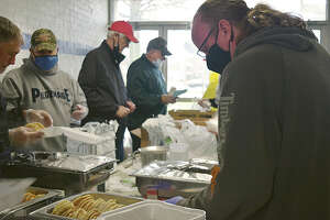 Kiwanis Club of Jacksonville member Rob Thomas makes a to-go box during the group's annual Kiwanis Pancake & Sausage Day in March.