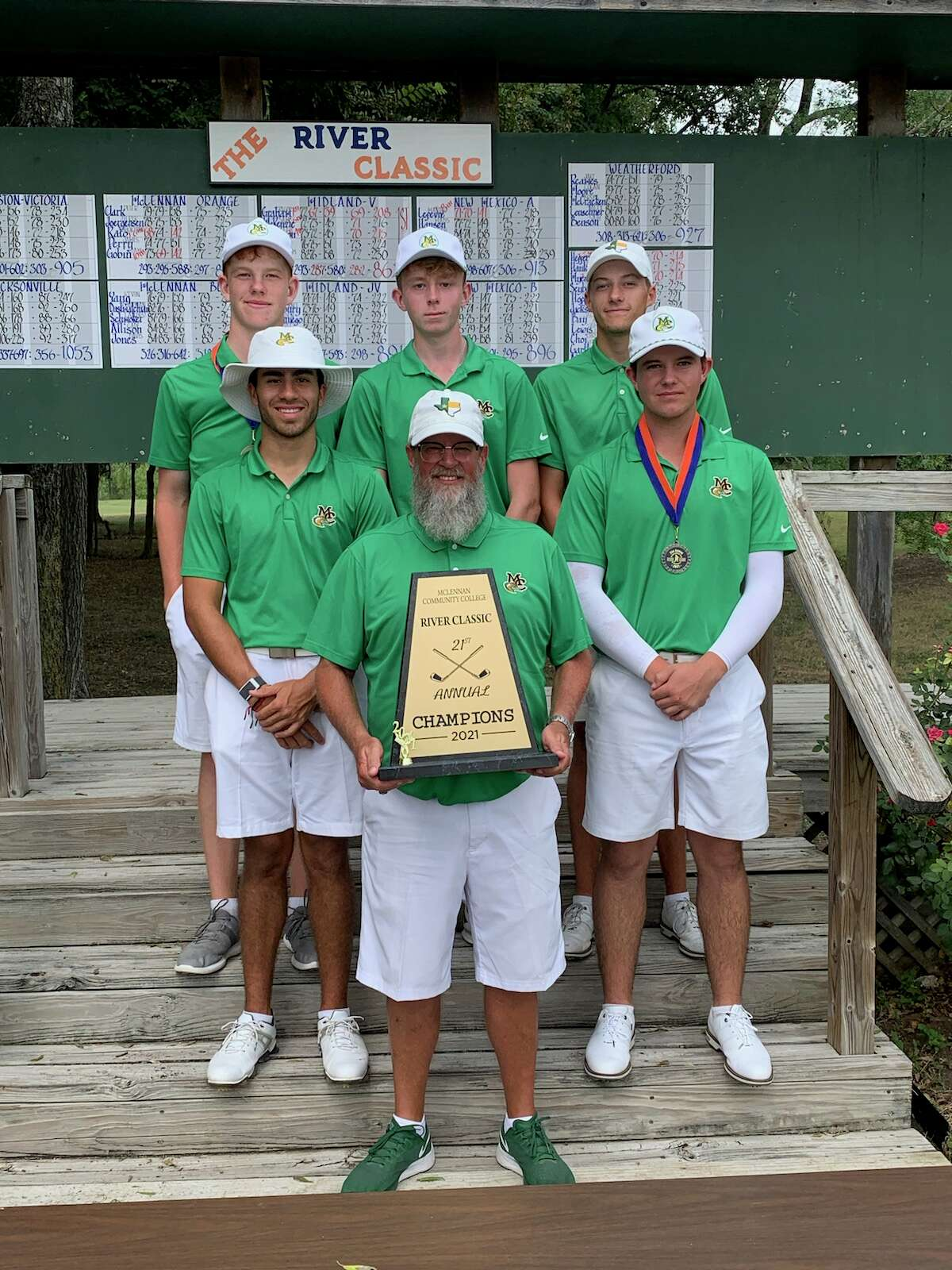 Midland College golf coach Walt Williams and the Midland College golf team pose with the championship trophy after winning the Bosque River Classic on Tuesday in Waco.