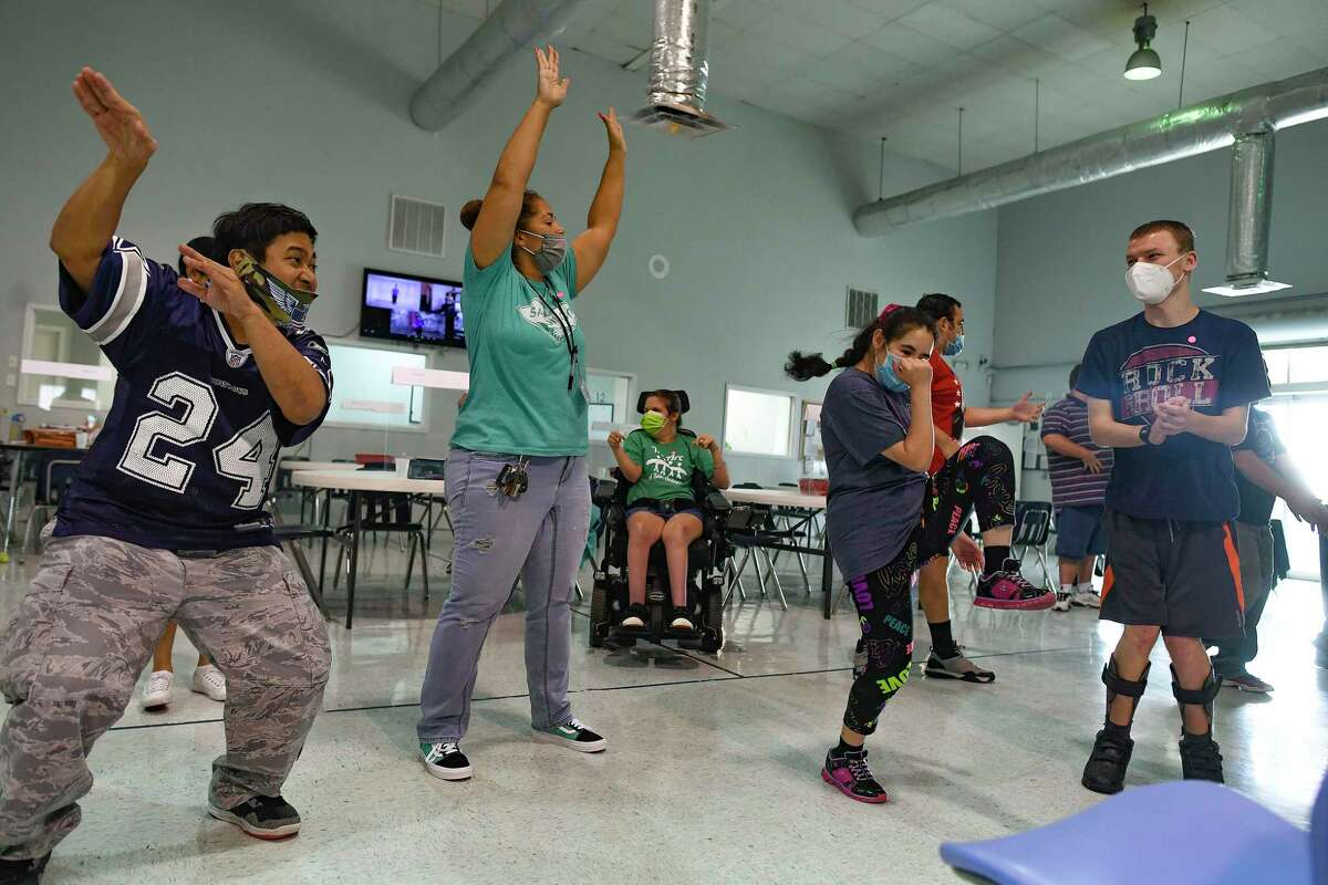 Johnny Campos, left, and other participants of The Arc of San Antonio's Adult Life Enrichment program dance during a SPIRIT Club Online fitness event Tuesday. The event coincided with the Big Give, a 24-hour fundraiser for South Central Texas nonprofits. The Arc of San Antonio supports and protects the human rights of people with intellectual and developmental disabilities.