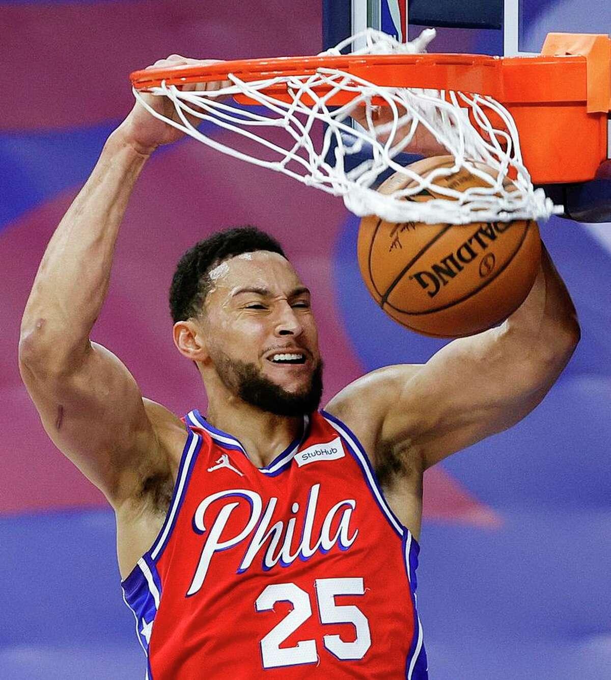 PHILADELPHIA, PENNSYLVANIA - JANUARY 22: Ben Simmons #25 of the Philadelphia 76ers dunks during the first quarter against the Boston Celtics at Wells Fargo Center on January 22, 2021 in Philadelphia, Pennsylvania.