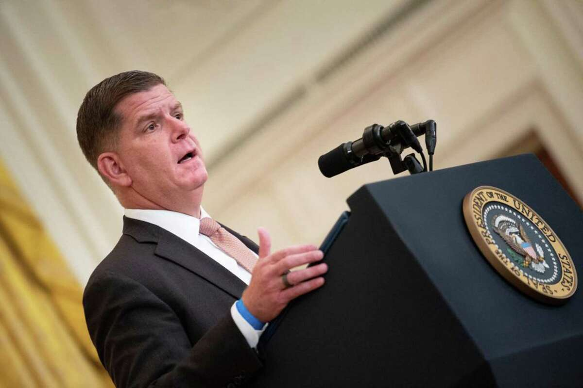 """US Secretary of Labor Marty Walsh in early September 2021 at the White House in Washington, D.C. In May under Walsh, the U.S. Department of Labor issued state labor commissioners a memo detailing specifics on how they should weigh any investigation into overpayments of unemployment benefits during the COVID-19 pandemic, including the possibility of """"blanket"""" waivers in collecting excess amounts paid out to claimants. (Brendan Smialowski/AFP via Getty Images/TNS)"""