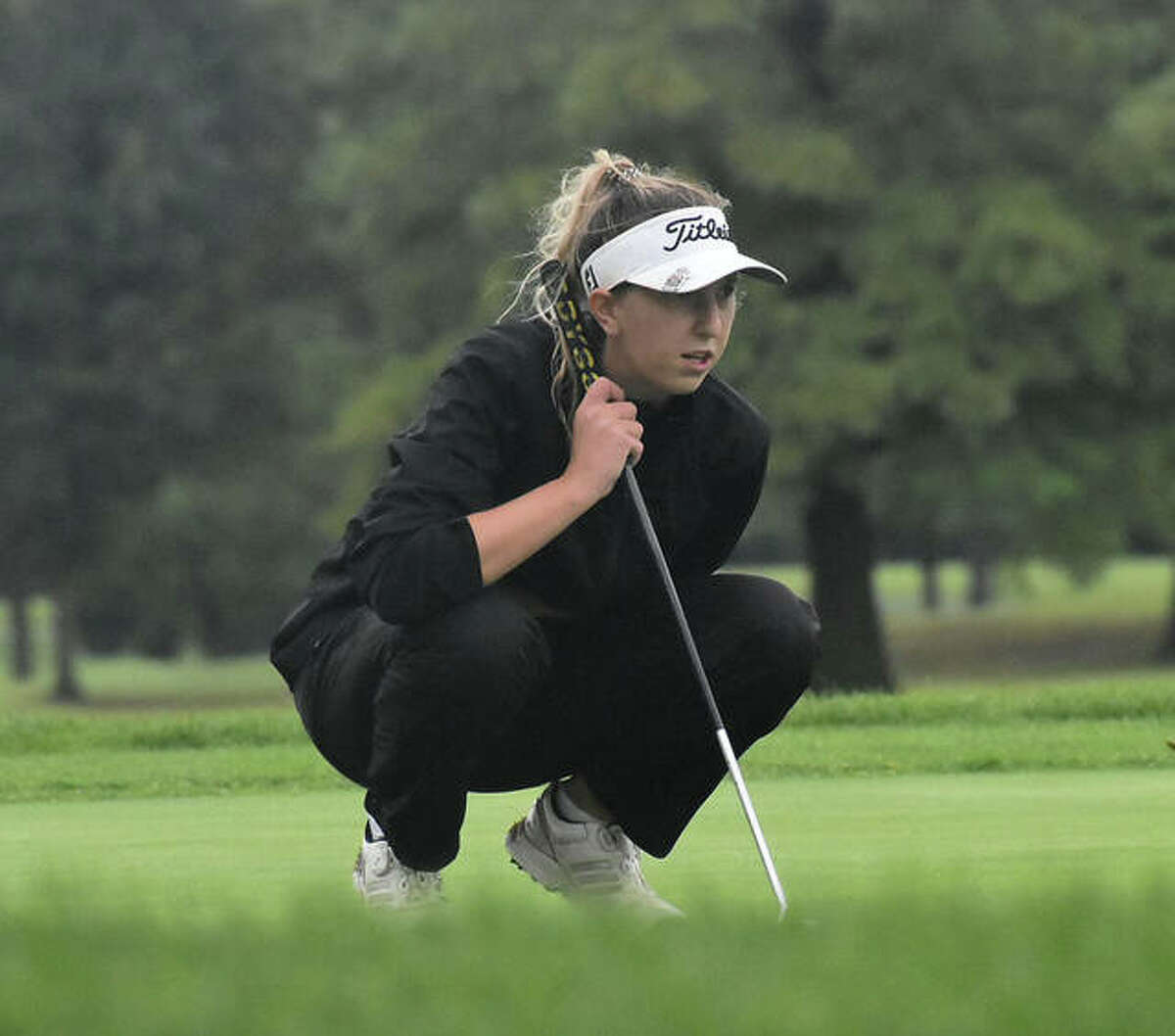 Edwardsville's Grace Daech judges the green on No. 18 during the second round of the Southwestern Conference Tournament on Tuesday at Belk Park Golf Course in Wood River.