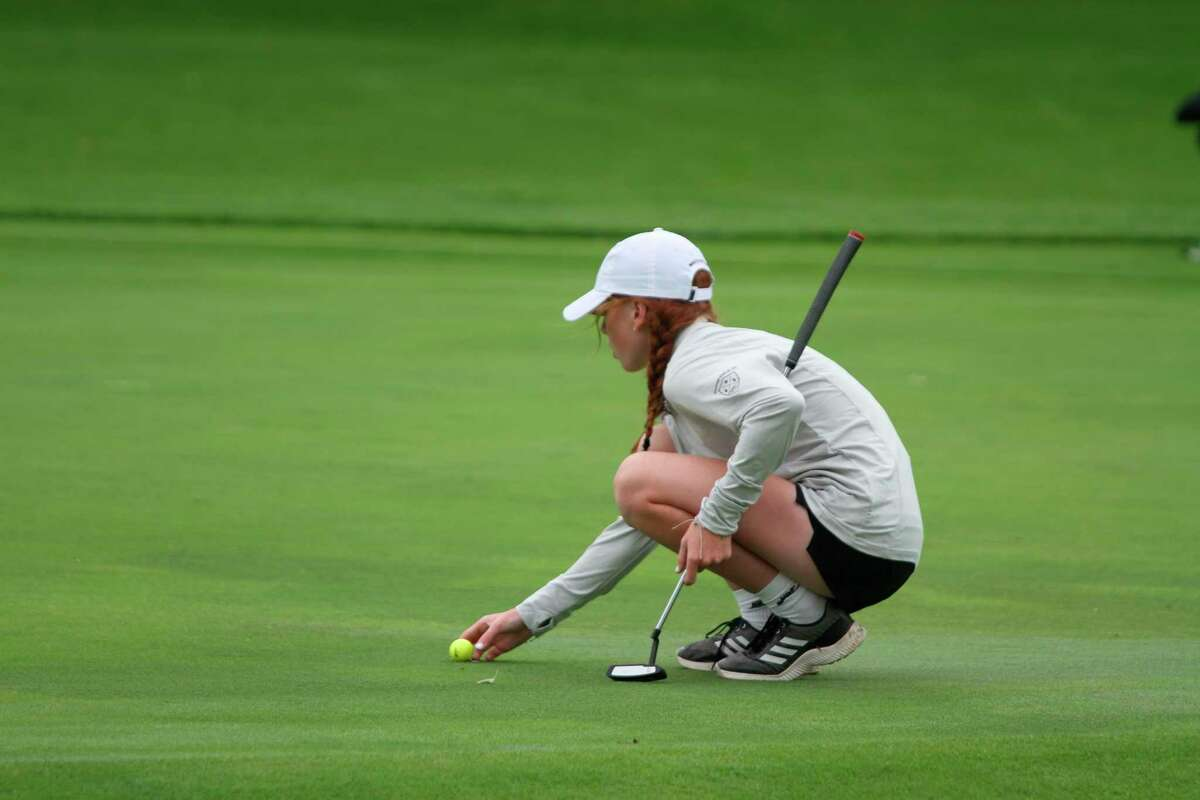 Manistee sophomore Kendal Waligorski lines up a putt on Tuesday afternoon. (McLain Moberg/News Advocate)