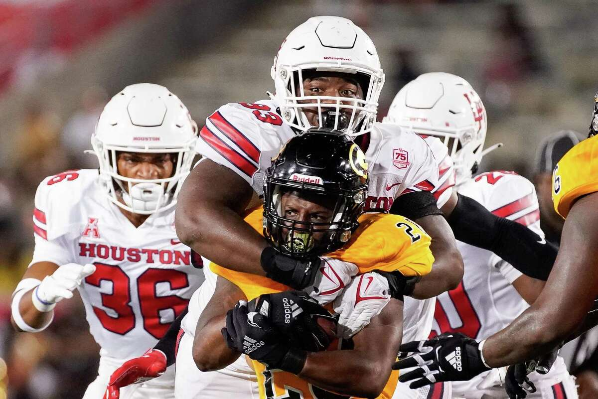 UH defensive lineman Atlias Bell (93) stops Grambling State running back Tyce Fusilier in his tracks during the Cougars' 45-0 victory this past Saturday at TDECU Stadium.