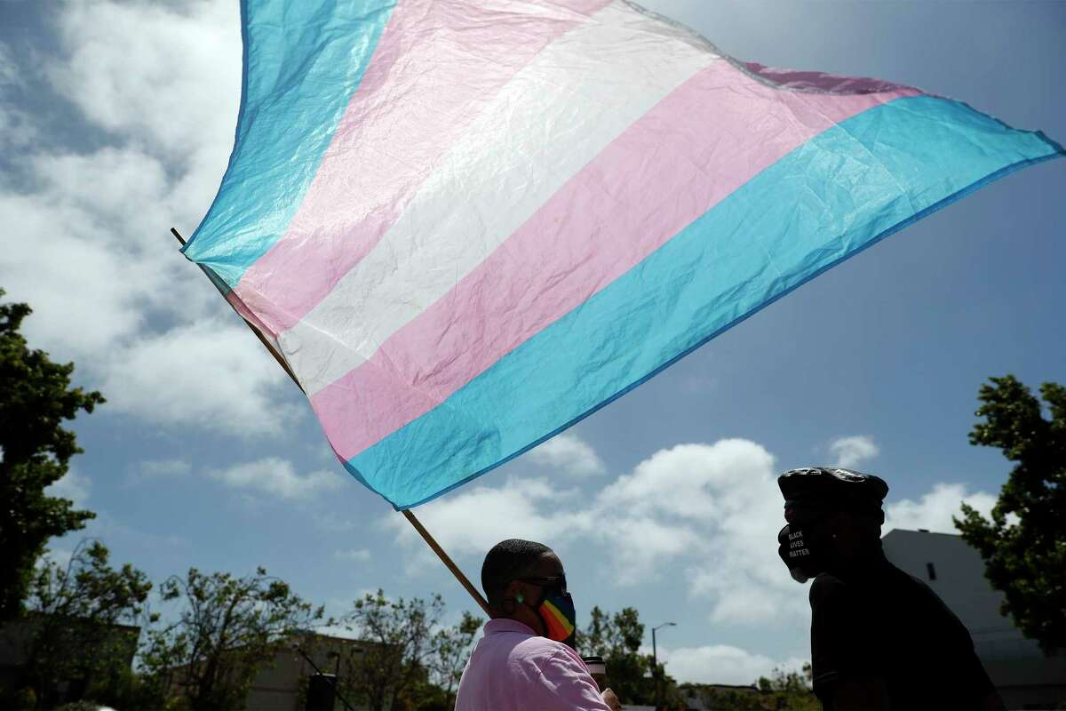 SF Pride Board President Carolyn Wysinger holds a transgender flag during the Marsha P. Johnson Solidarity Rally at the African American Art & Culture Complex in San Francisco last year in June. California is starting a pilot program to track the number of LGBTQ people in the state who suffer violent deaths.