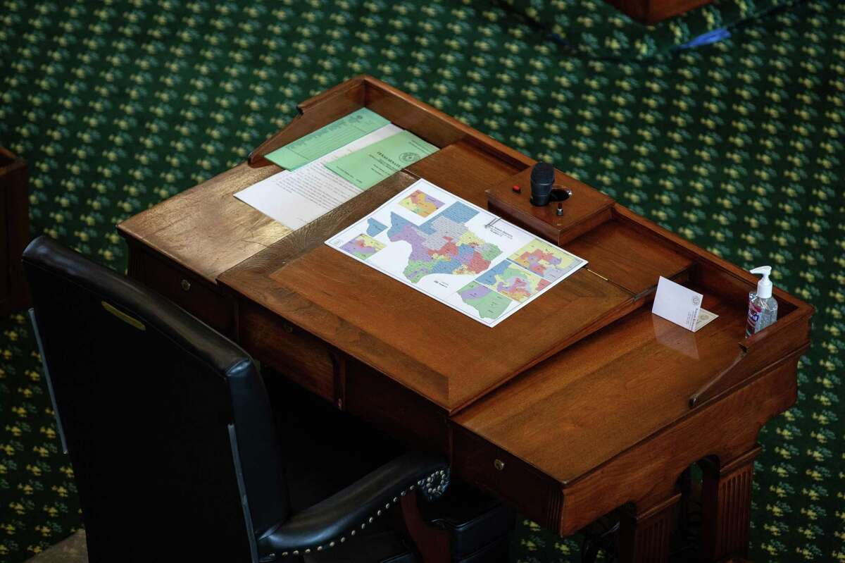A map of state Senate districts is seen on a desk in the Senate chamber on the first day of the 87th Legislature's third special session at the State Capitol on September 20, 2021 in Austin, Texas.