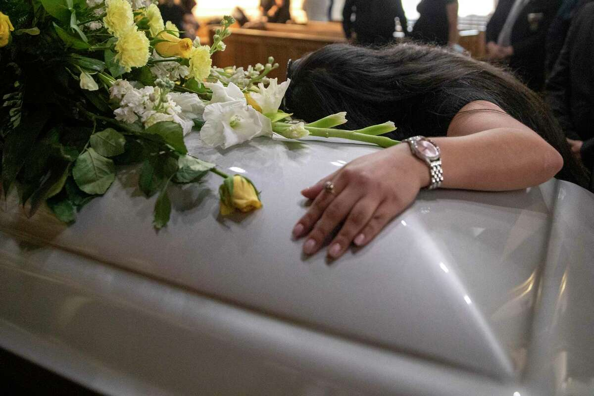 Desiree Arreola says her final goodbyes to her grandfather, Jose Bustos, who died of COVID-19. Arreola also lost her mother and aunt to the virus.
