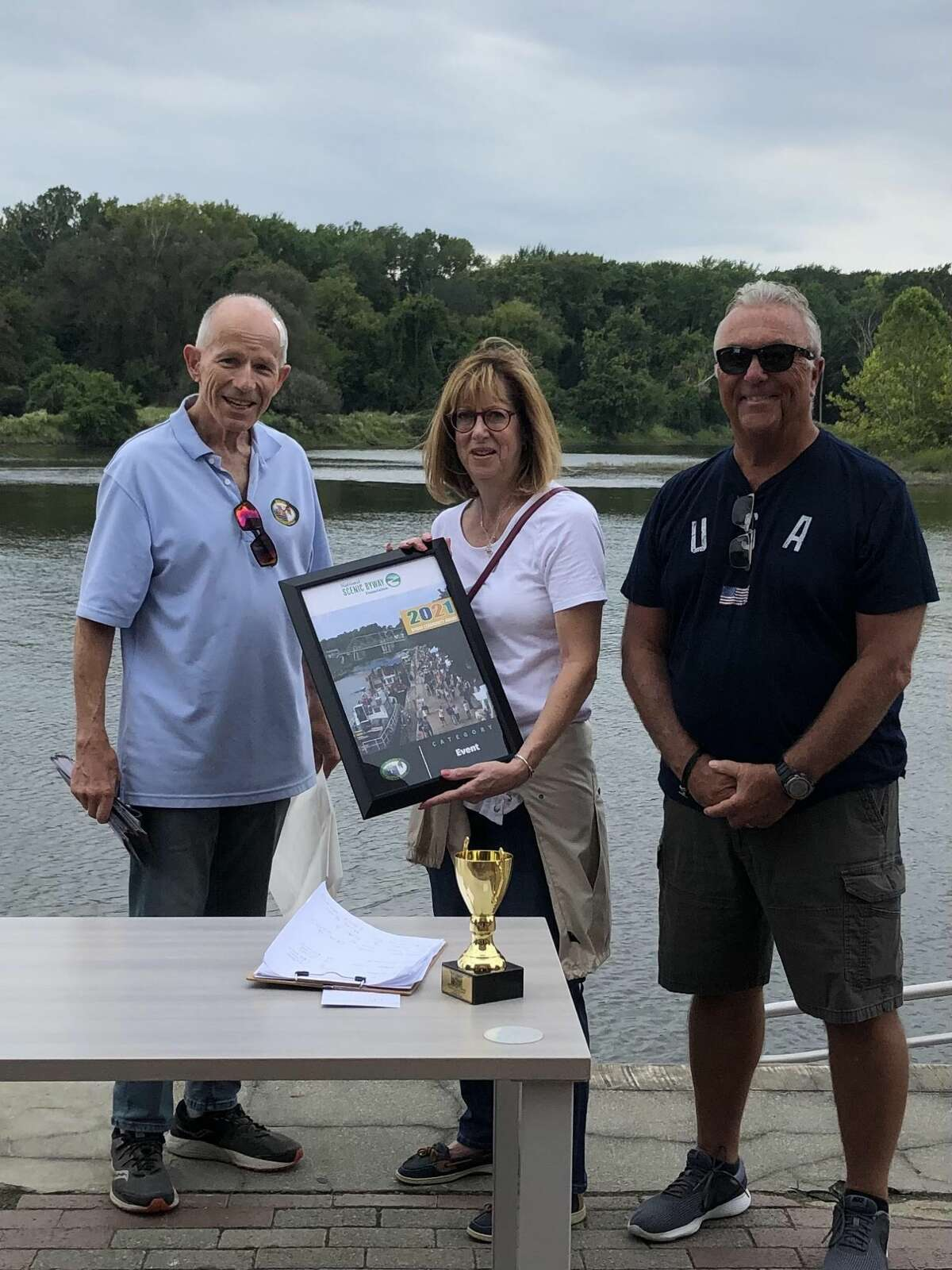 Mohawk Towpath Scenic Byway Executive Director Eric Hamilton presents the Town of Waterford with the National Byway Community Award at the recent Tugboat Roundup held in Waterford. The award recognizes the success of byways and the community leaders. Left to right: Eric Hamilton, Town Councilwoman Laurie Marble, Town Councilman Jim Boudreau.