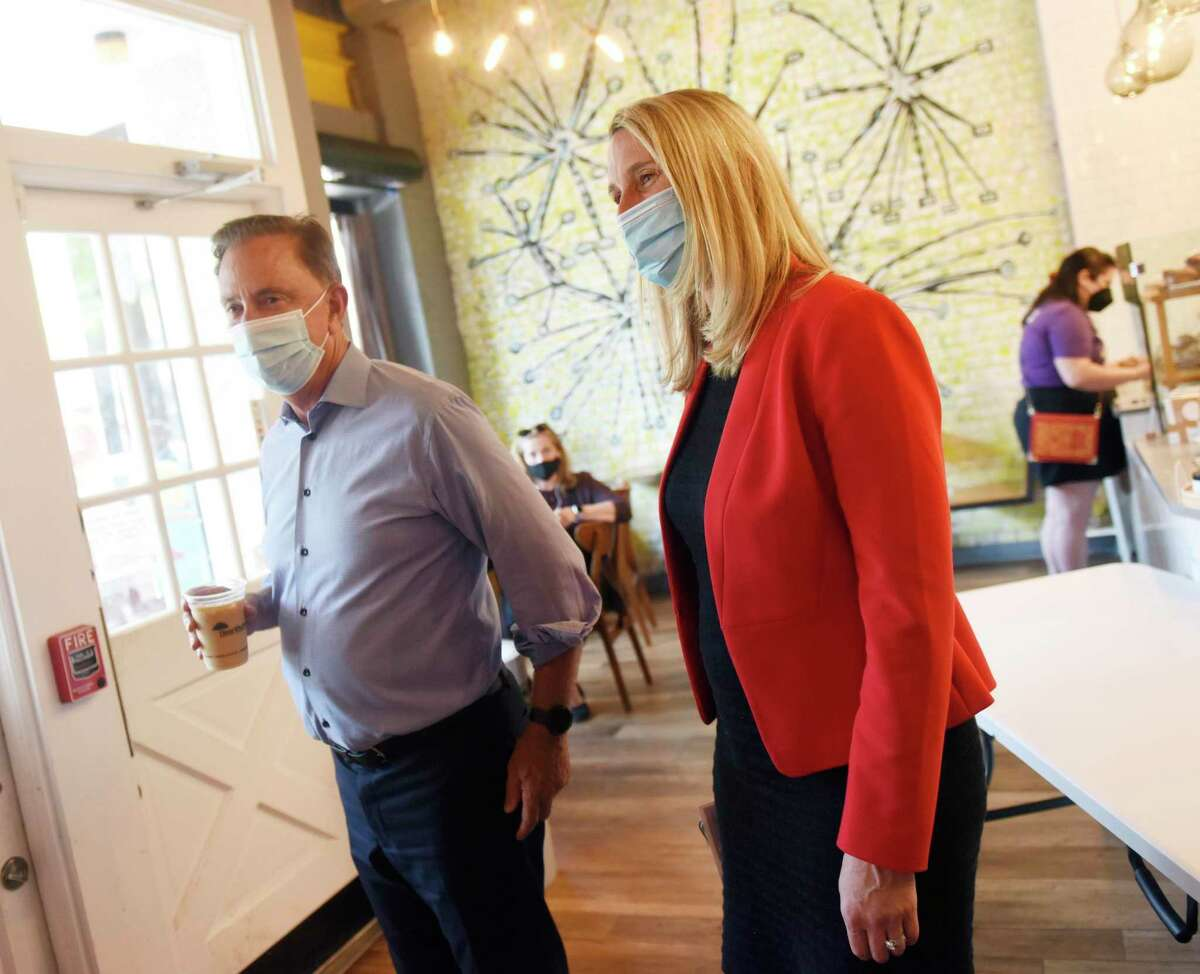 Connecticut Gov. Ned Lamont and Stamford Democratic mayoral candidate Caroline Simmons visit Lorca coffee shop in Stamford, Conn. Monday, Sept. 20, 2021. Gov. Lamont visited Stamford Monday to talk with small businesses and endorse Caroline Simmons for Mayor of Stamford.