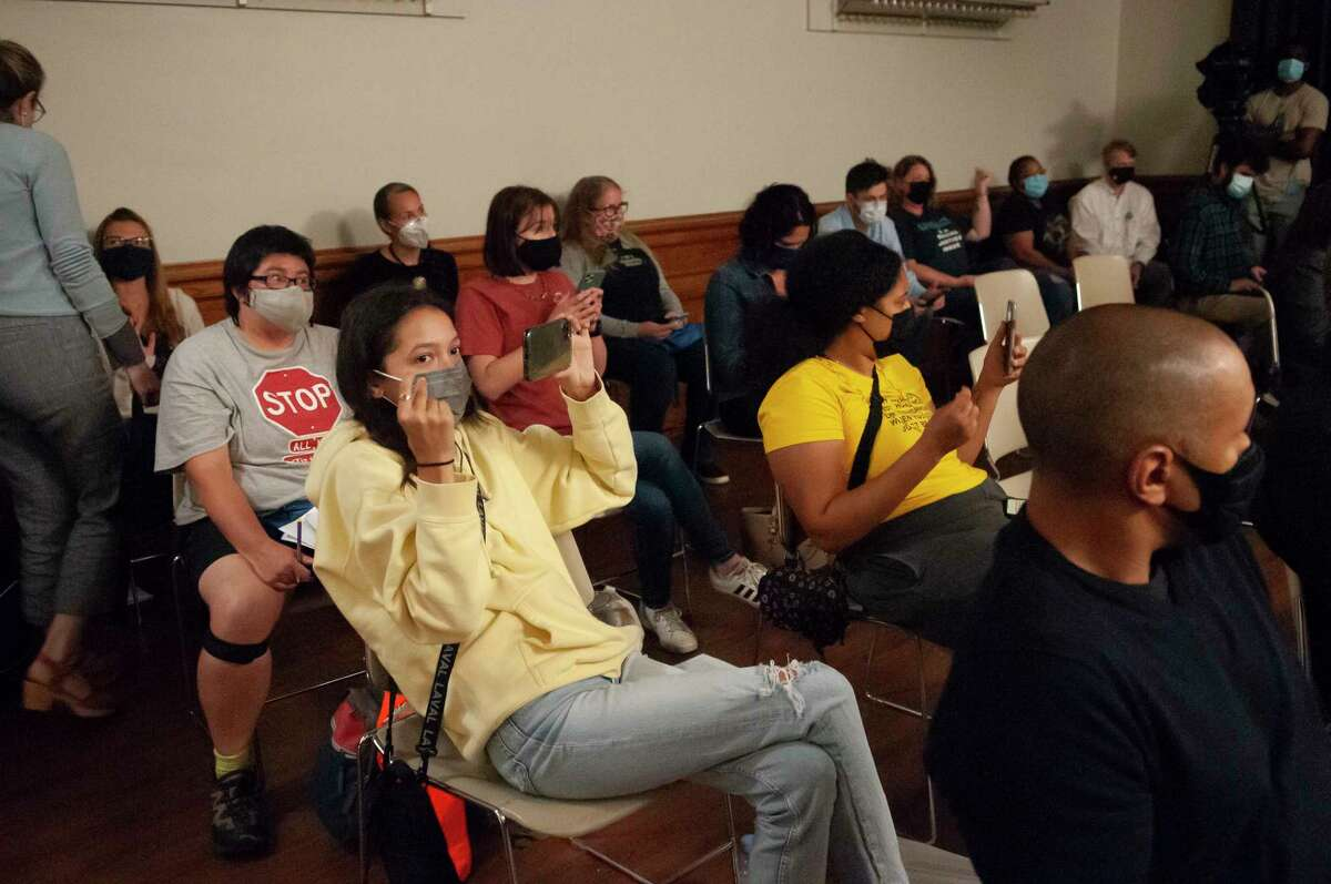 Activists and concerned residents snap fingers in agreement with a public speaker at a Saratoga Springs City Council meeting in City Hall on Thursday, Sept. 21, 2021. (Jenn March, Special to the Times Union)