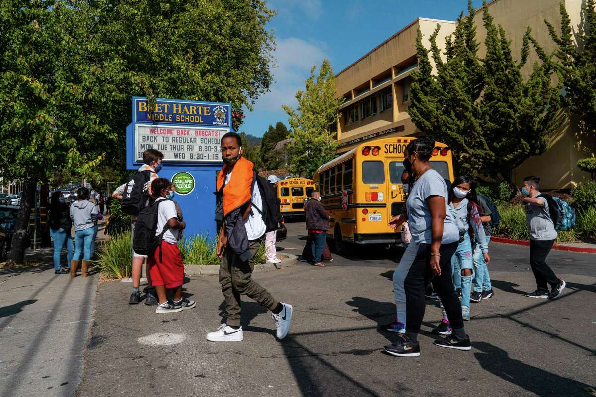 Students leave campus as school lets out at Bret Harte Middle School in Oakland, Calif., on Tuesday, September 16, 2021.