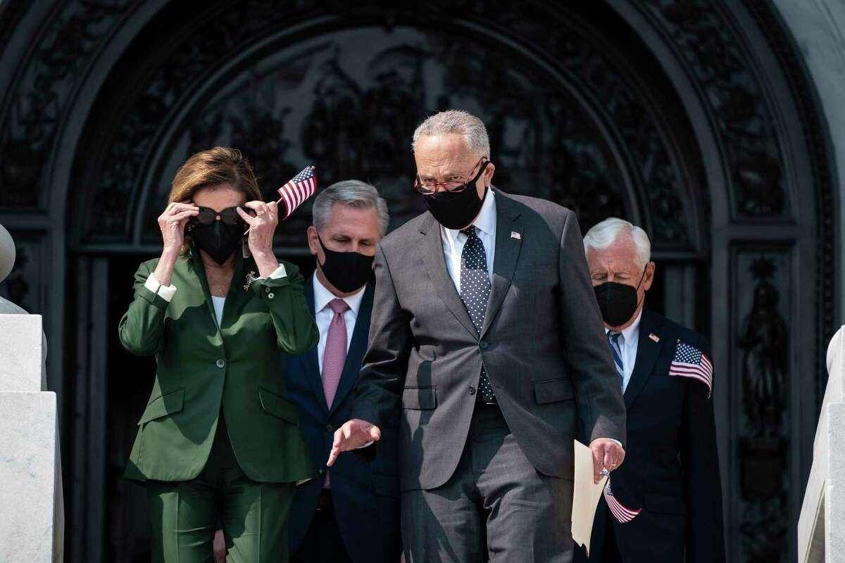 Speaker of the House Nancy Pelosi, D-Calif., speaks with Senate Majority Leader Charles Schumer, D-N.Y., as they walk out with House Minority Leader Kevin McCarthy, R-Calif., as they arrive for a Sept. 11 remembrance ceremony on Capitol Hill on Monday, Sept. 13, 2021 in Washington.