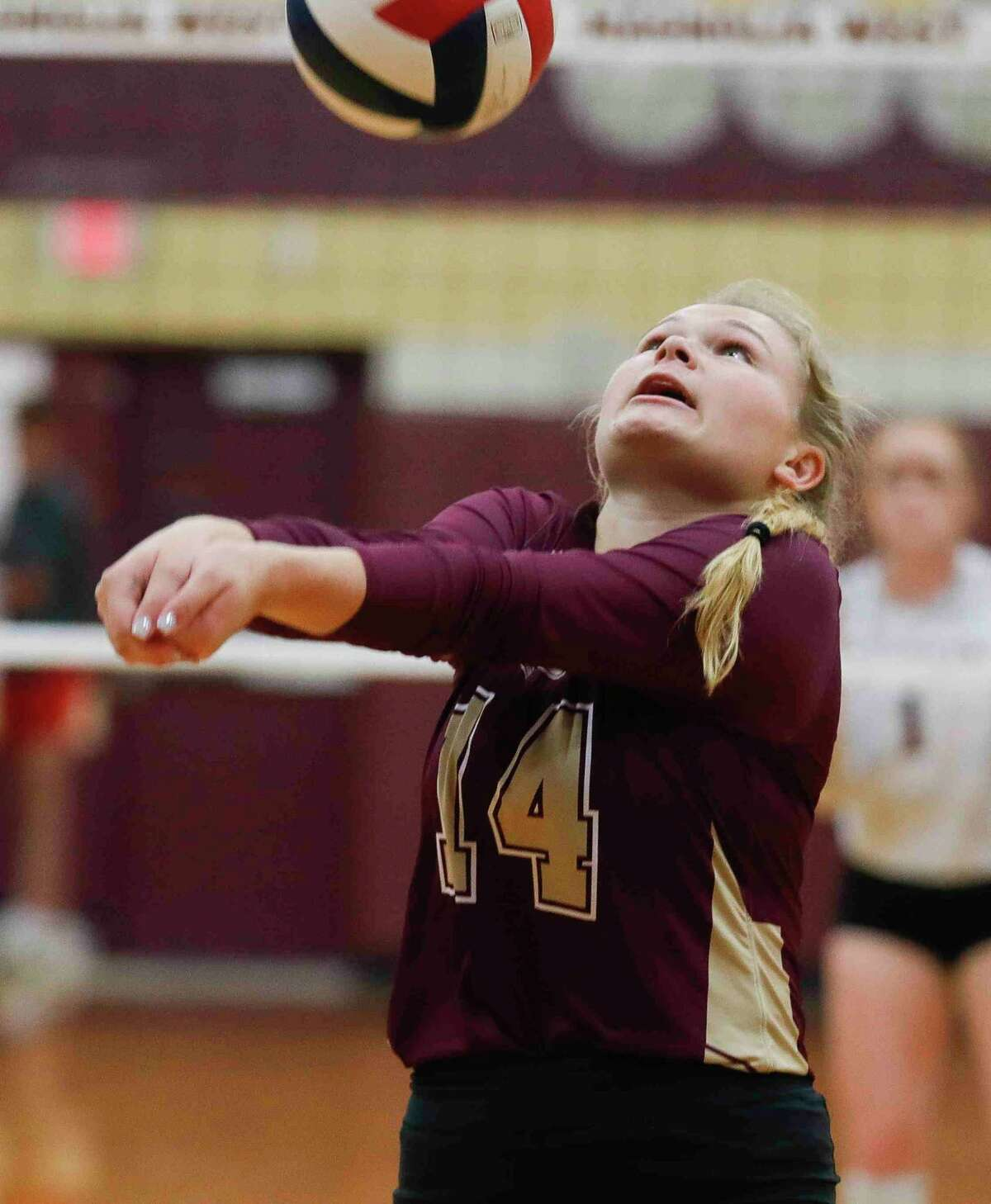 Magnolia West's Kassidy Johnson (14) returns a hit during the first set of a District 19-5A high school volleyball match at Magnolia West High School, Tuesday, Sept. 21, 2021, in Magnolia.
