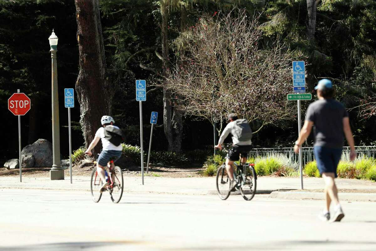 Cyclists pass disabled parking spots west of Eighth Avenue on John F. Kennedy Drive on Monday. One proposal would allow traffic west of Eighth again.