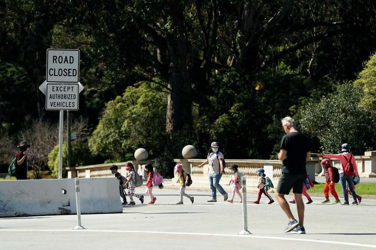 Children cross John F. Kennedy Drive at Hagiwara Tea Garden Drive on their way to the museums.