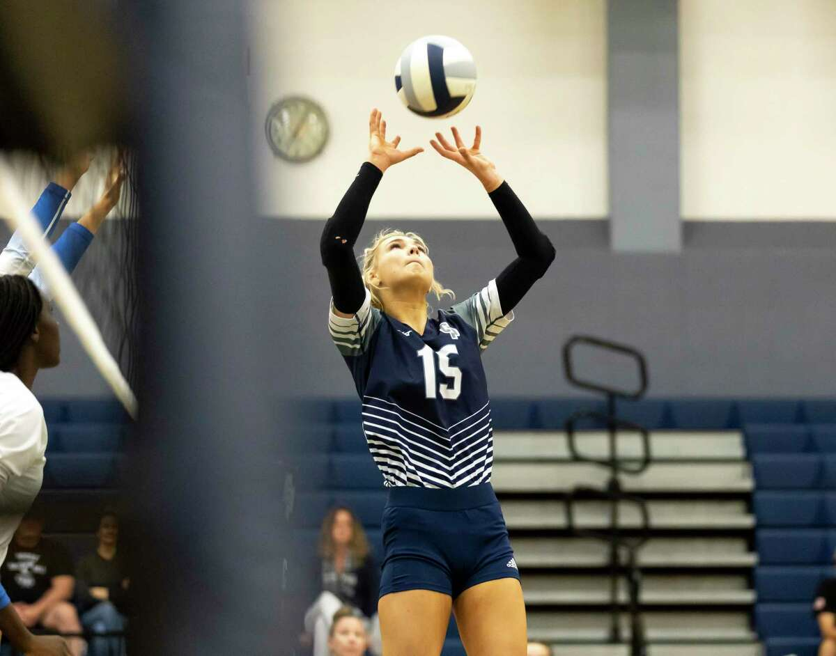 College Park setter Paige Bernstein (15) prepares the ball for a play during the second set of a District 13-6A volleyball match against Grand Oaks at College Park High School, Tuesday, Sept. 21, 2021, in The Woodlands.