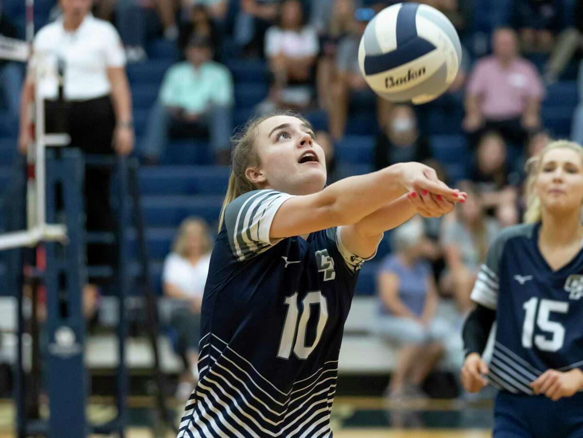 College Park middle hitter Cassidy Coperland (10) returns the ball during the third set of a District 13-6A volleyball match against Grand Oaks at College Park High School, Tuesday, Sept. 21, 2021, in The Woodlands.