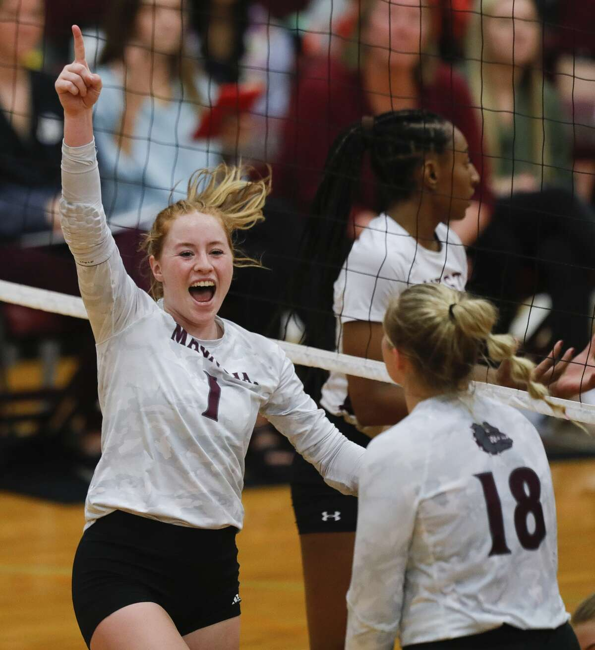 Magnolia outside hitter Kaylee Kelton (1) cheers after a point during the third set of a District 19-5A high school volleyball match at Magnolia West High School, Tuesday, Sept. 21, 2021, in Magnolia.