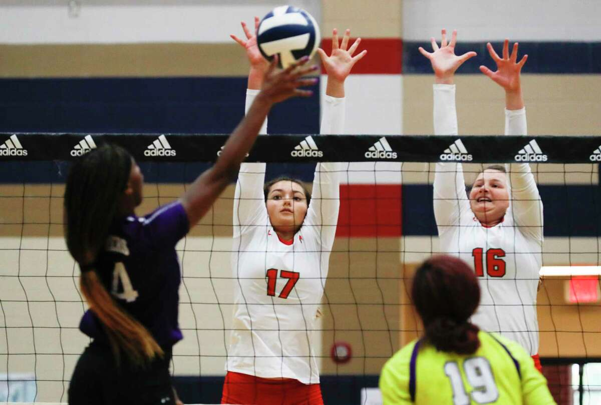 Shown here earlier this season, The Woodlands setter Claire DeWine (17) and middle blocker Marjorie Johnson (16) helped the Lady Highlanders to a sweep of Willis Tuesday night.