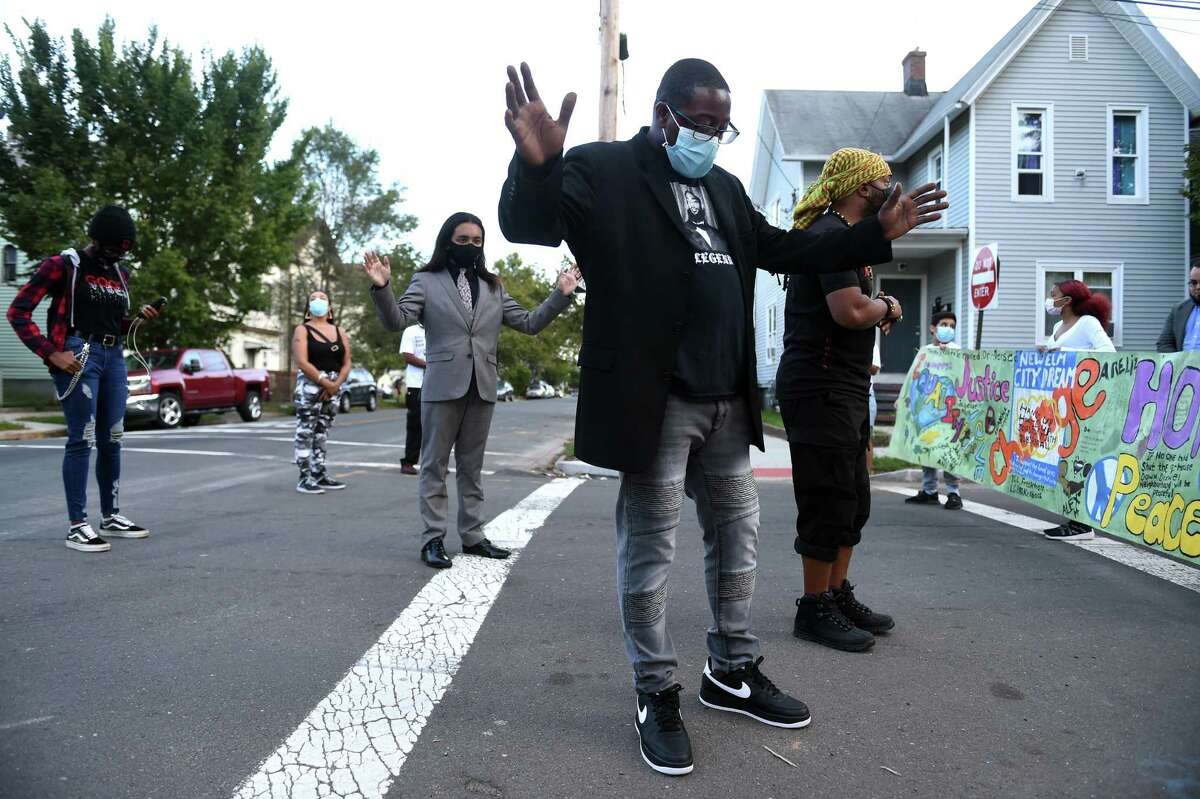 A march organized by the anti-violence group, Ice the Beef, makes a stop at the corner of Lloyd and Wolcott Street in Fair Haven on September 21, 2021 following an increase in gun violence and a series of shootings in Fair Haven. At center is Ice the Beef president Chaz Carmon.